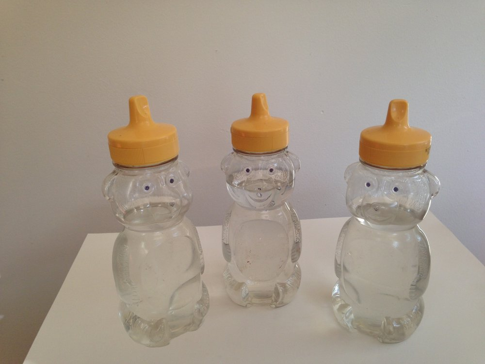 Navel,  2011 Plastic honey bear bottles, water collected from the Frio, Nueces, & Leona rivers 6.5 x 2.5 x 2 inches (each)