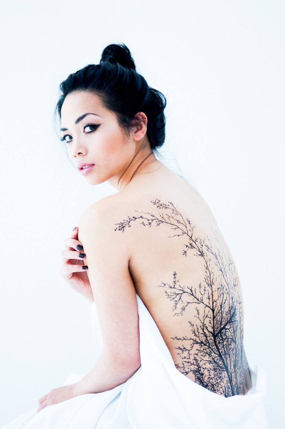Photography: Sebastien P. photography Model: Christine Christine Jimenez Muñoz Make-up & Manicurist: Elody.R -Make Up Temporary Tattoos: Frederic Carrasco