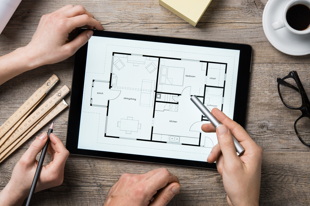an ipad showing a house blueprint.png