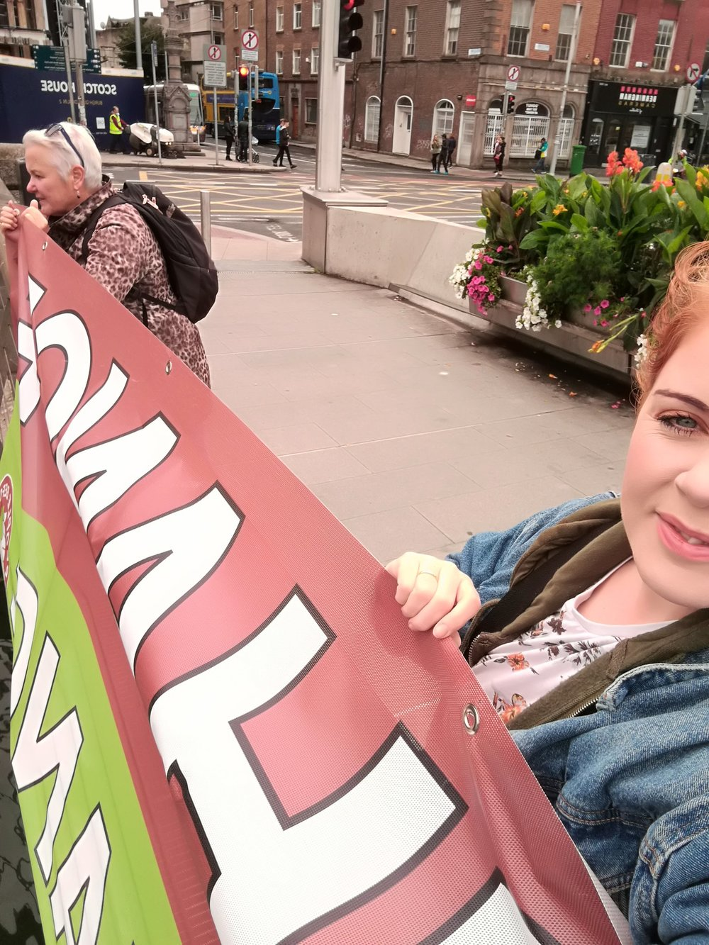 Holding the very heavy climate sign
