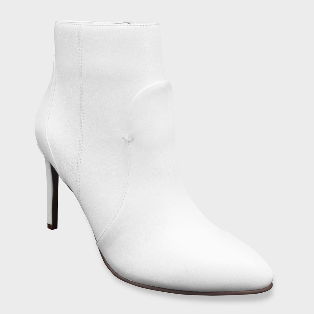 Considering pairing  these  booties with a white sweater dress or go for a more casual look with mom jeans and a classic white shirt, tied at the waist with bold silver earrings.