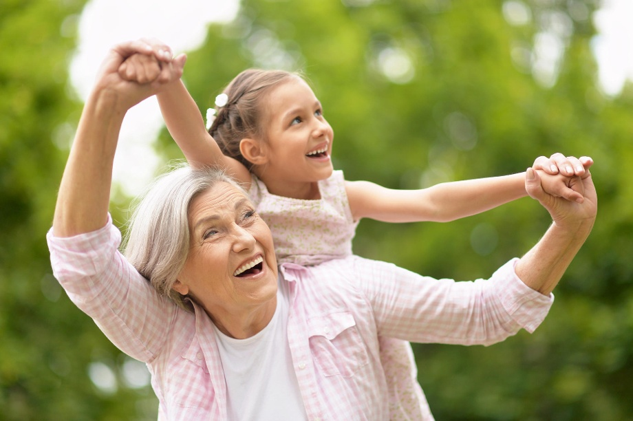 Depiction of a grandmother playing worry free with her granddaughter. An example of an Aurum Fitness customer