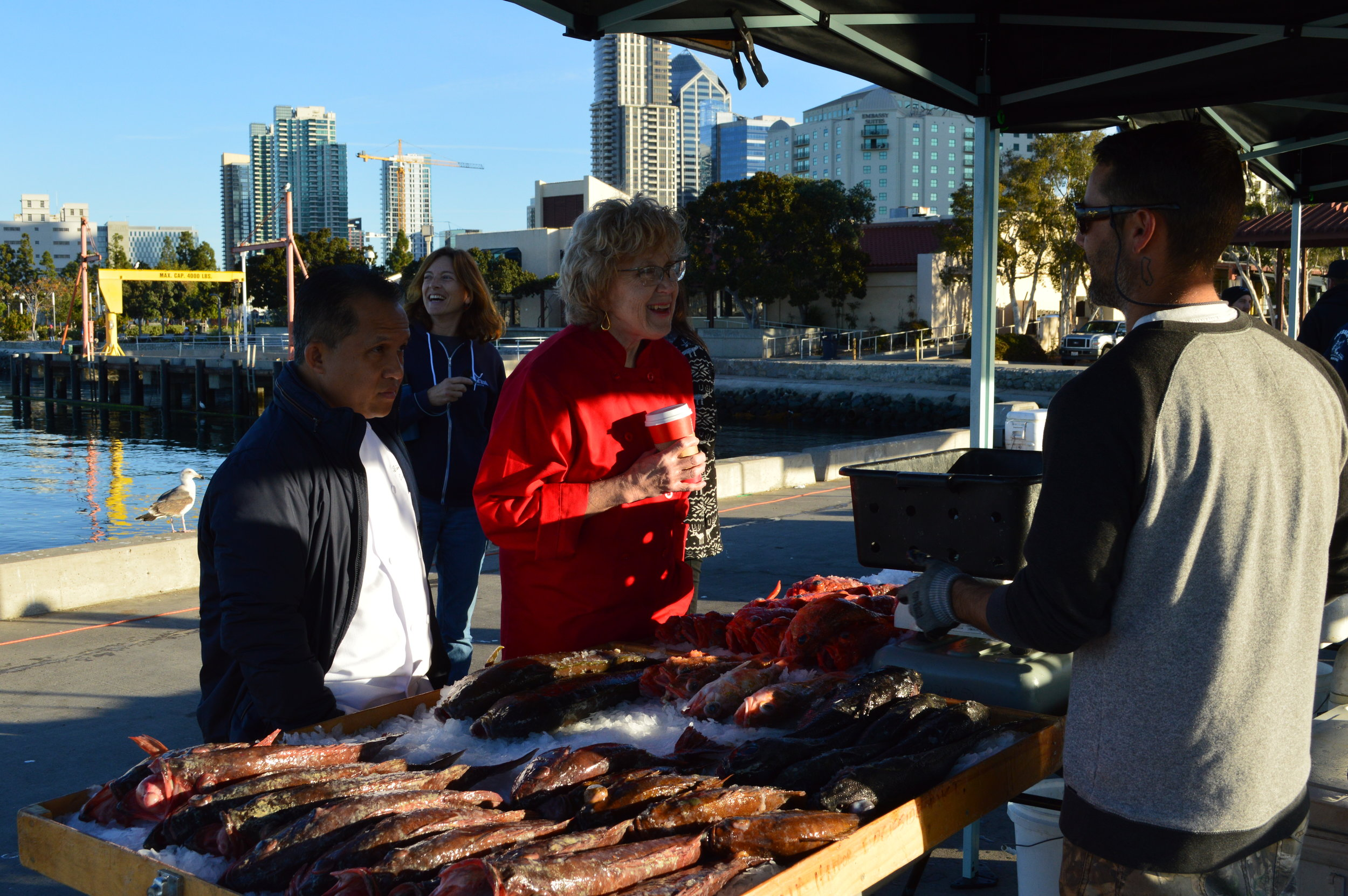 Manchester Grand Hyatt Executive Chef Sutti Sripolpa and Scripps Mercy Chef Cindy Quinonez admire the wide variety of rockfish available at Tuna Harbor Dockside Market