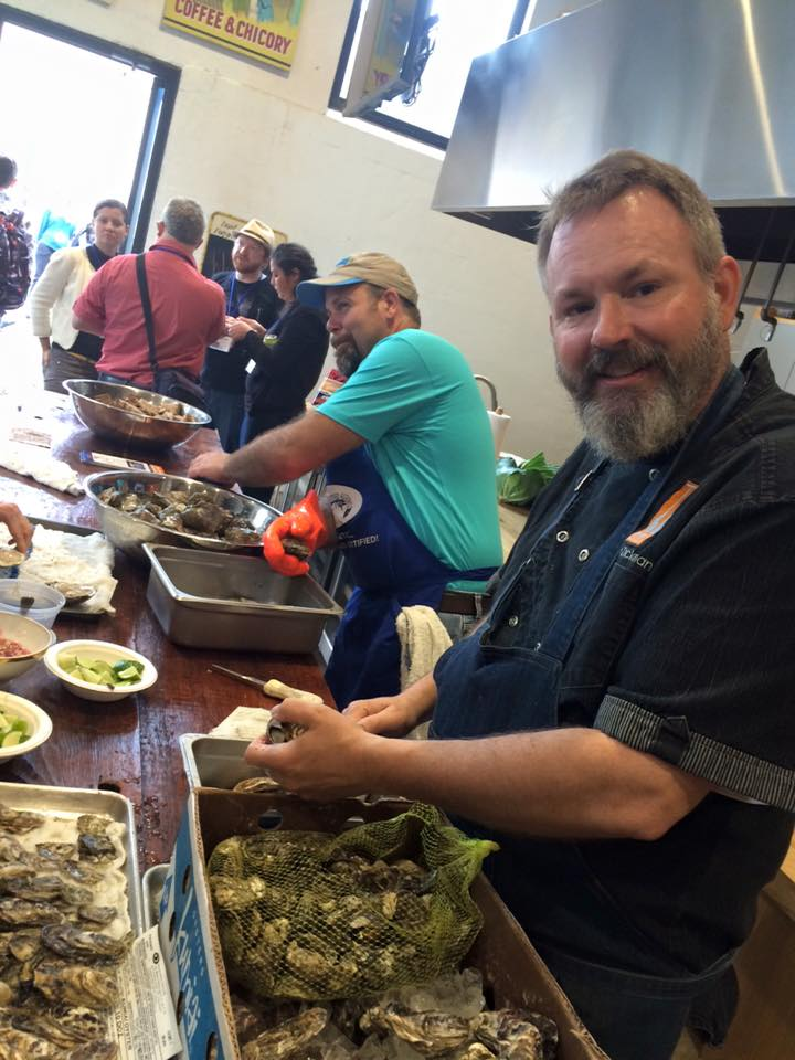 Slow Food Urban San Diego member, CHef Drew Deckman and Louisiana fishermen, Lance Nacio shucking oysters -- Baja Kumiai and Louisiana. Photo: S. Shoffler