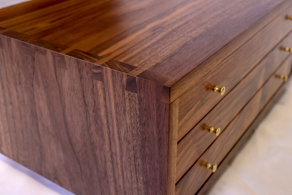 Jewelry Case - Black walnut case, dovetails throughout, exotic Chechen drawer fronts, black velvet interior with lap jointed dividers. This project was a skill builder.