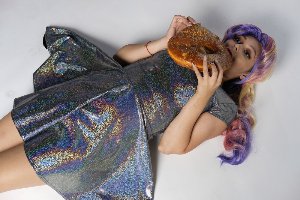 Mermaid Child in Sugarbelle cosplay with donuts at Waveform Austin