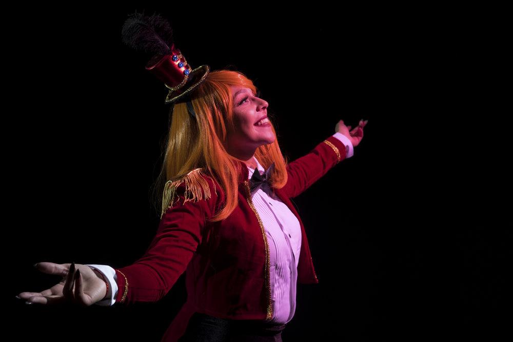 Mermaid Child in Honoka Kousaka cosplay dressed as a circus ringmaster at Soundcheck Austin