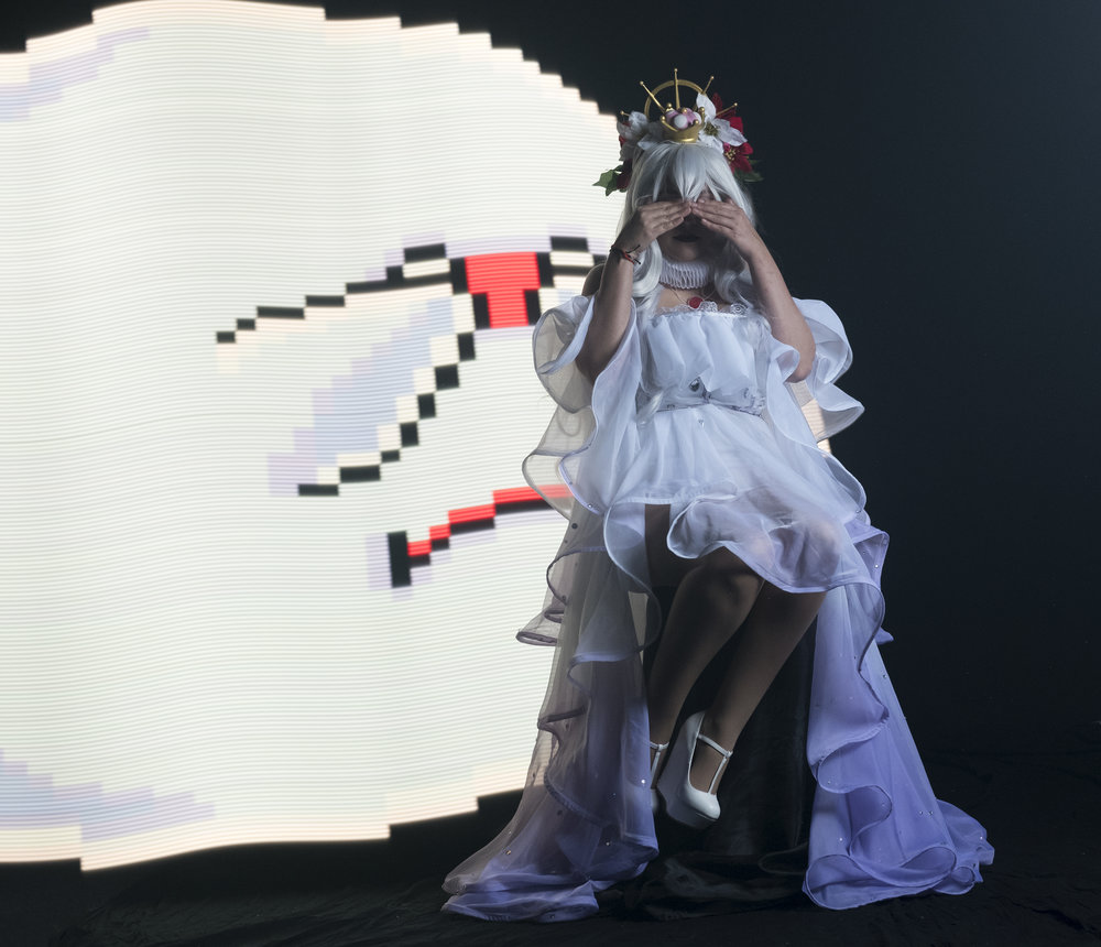 Mermaid Child cosplaying as Hannah Alexander's Boosette with a Big Boo from Super Mario World light painted behind her