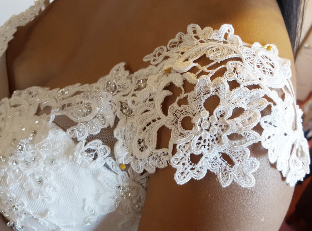 Custom sleeve addition for wedding dress by Natasha, our in-house seamstress.