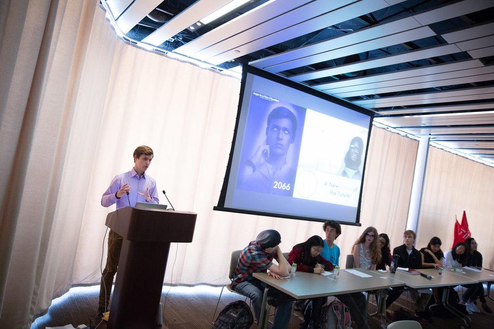 UCSD undergraduate Aragon de La Poeze d'Harumbare presenting his vision of the future in 2066