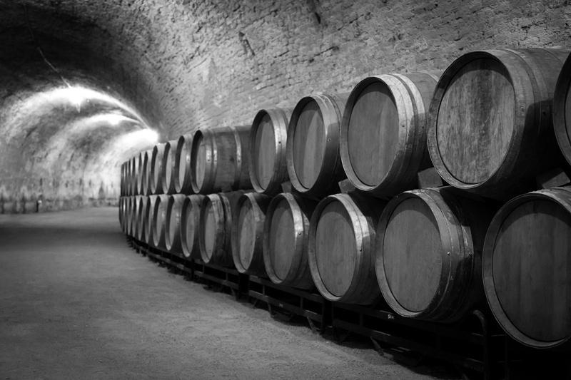 wine-aging-barrels-cellar.jpg