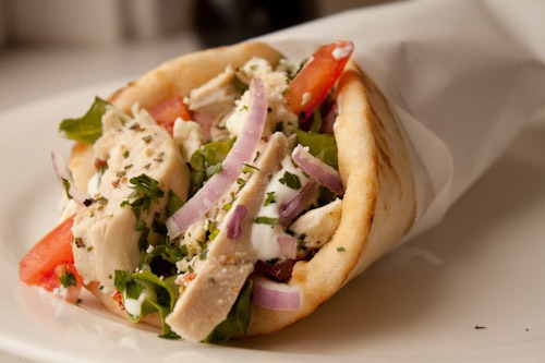 PITA WRAPS - Comes with your choice of soup, salad, or fries.warm pita with onions, tomatoes, and homemade tzatziki.