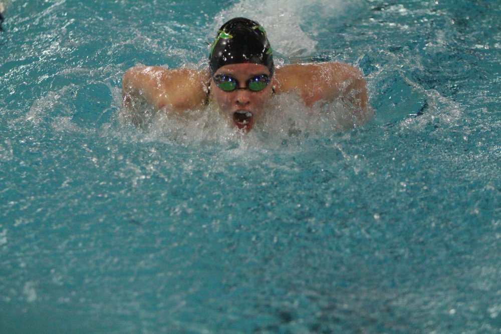 Junior Teagan Haberkorn swims the butterfly during a home meet.