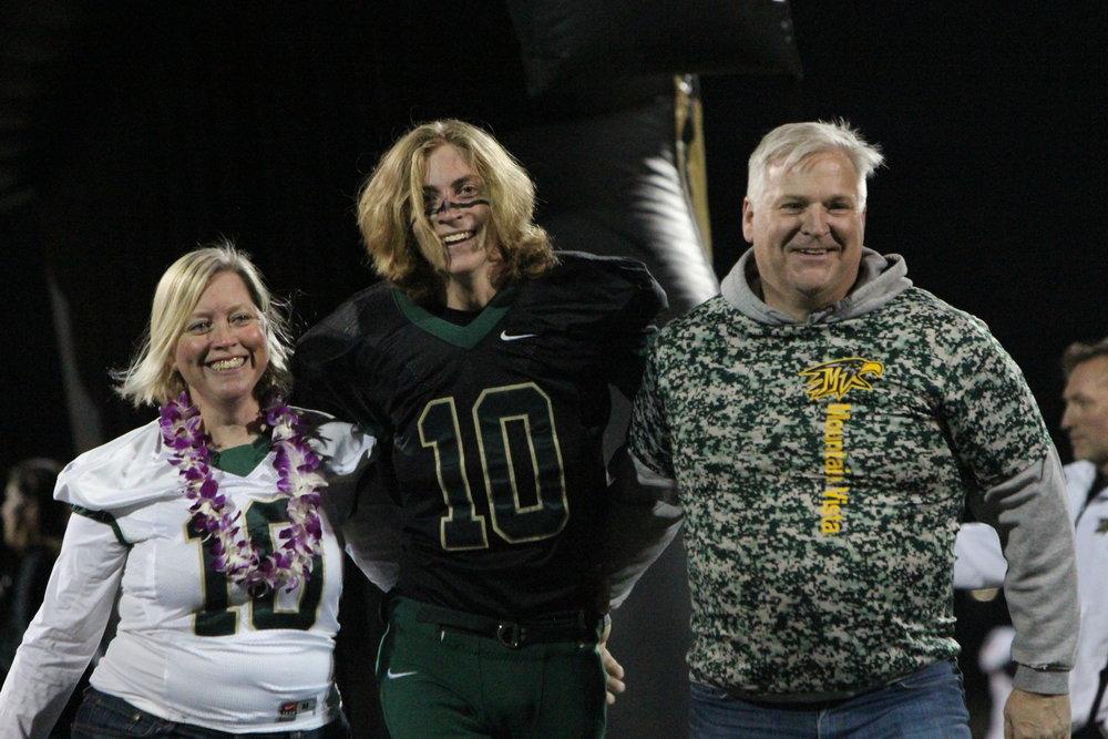 Senior Chase Mackey walks through the tunnel celebrating his career in high school football.