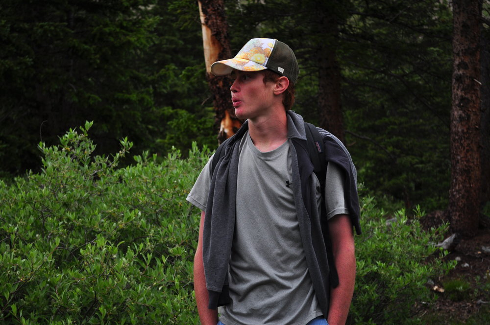 Evan Place whistles as he hikes up a mountain in Buena Vista.
