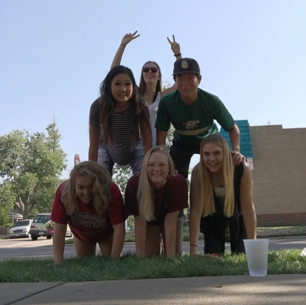 At our annual BBQ, we participated in a human pyramid as one of the scavenger hunt events.