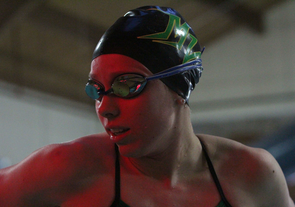 Junior Teagan Haberkorn waits for her time to be announced after swimming the 50 freestyle swimming event.