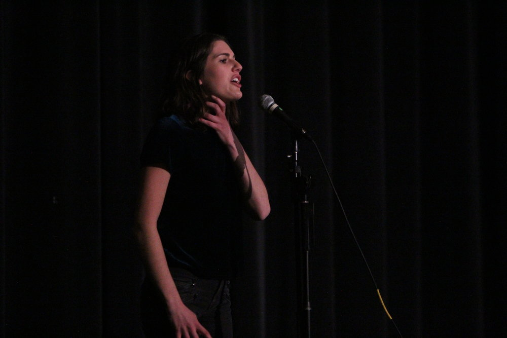 Senior Hannah Lovell preforms her original poem at the second annual slam poetry contest.