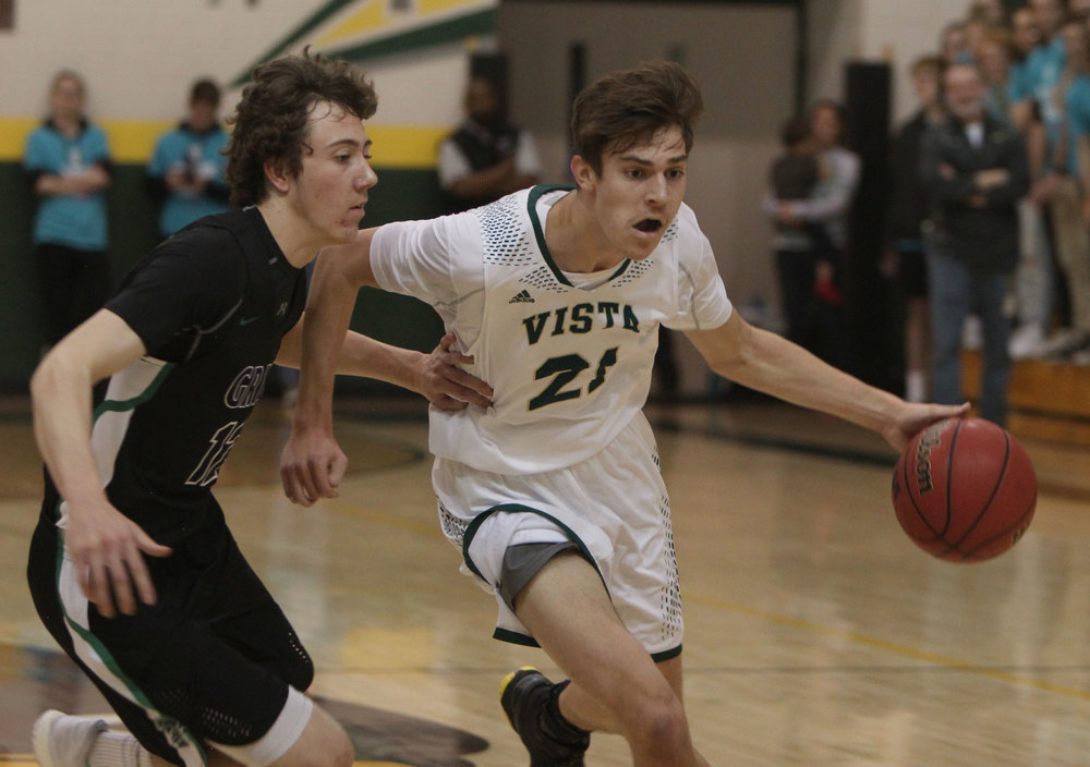 Senior Connor Staib dribbles around his opponent in the rivalry game against ThunderRidge High School.