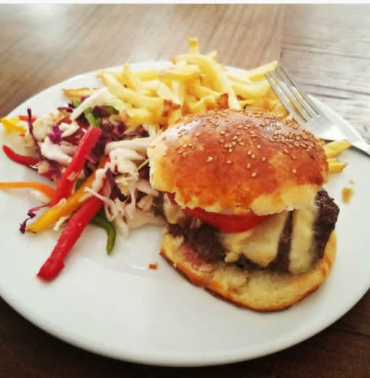 Photo Courtesy IG: @_JMarieTravels. Camel Burger from Cafe Clock in Marrakech.