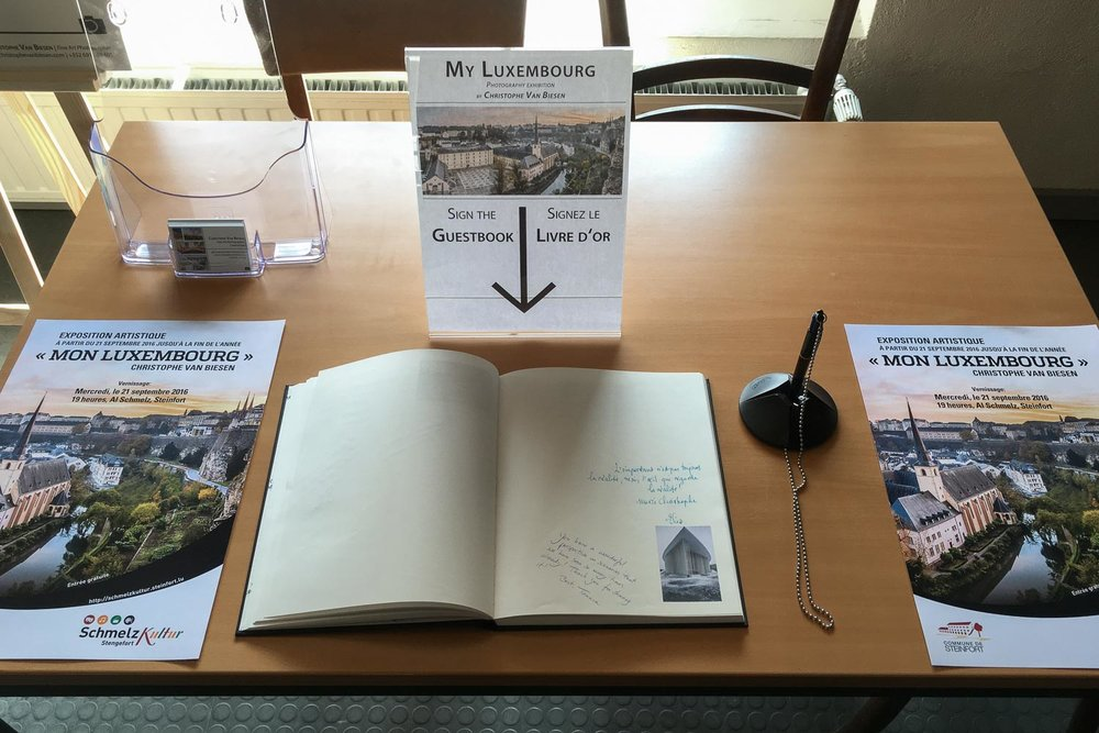 Sign the Guestbook at the My Luxembourg Exhibition by Christophe Van Biesen at the Centre Culturel Al Schmelz in Steinfort, Luxembourg