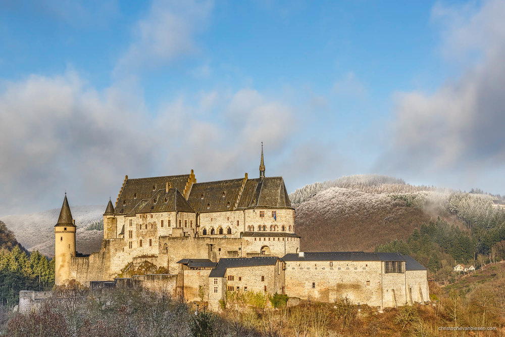Snow in Luxembourg - Luxembourg's Vianden castle on a cold winter day - Vianden Castle amidst Sun and Snow