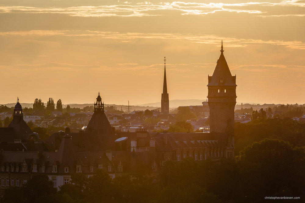 Luxembourg City - Luxembourg's BCEE tower and the bell tower of the Belair church bathing in warm sunset light - Golden Dusk