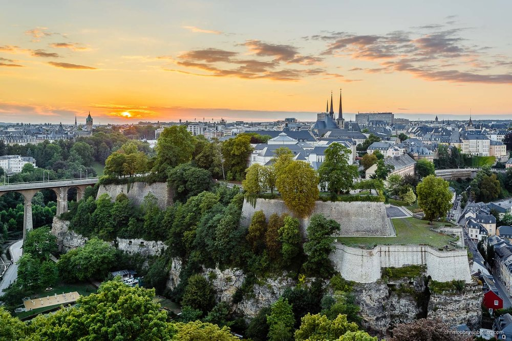 Luxembourg City - Sunset over Luxembourg City's Corniche with the roofs of Notre-Dame and the BCEE tower in the distance - Summer Solace