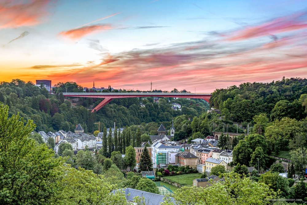 Summer in Luxembourg - Red Bridge, or Grand Duchess Charlotte Bridge, joins the two opposite sides of the Pfaffenthal valley, from Limpertsberg to Kirchberg - Red Steel