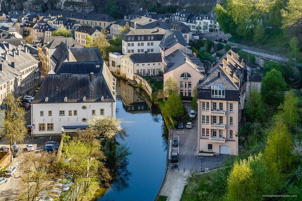 Summer in Luxembourg - Luxembourg's Grund neighbourhood as seen from the Bock - Still Riverside