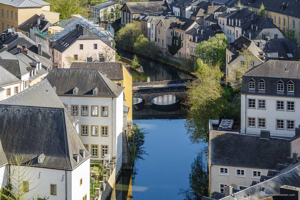 Summer in Luxembourg - Luxembourg's Grund neighbourhood with its iconic bridge crossing the Alzette river - Serene Waters