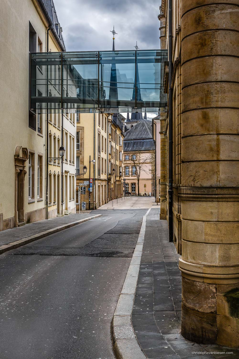 Narrow Streets of Luxembourg City - Rue de l'eau with its glass bridge of the Parliament and the towers of the Notre-Dame cathedral in the background - The Narrows I