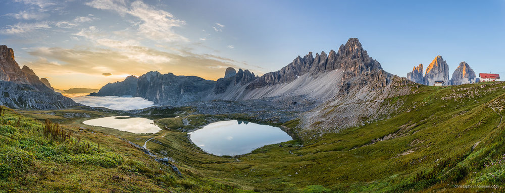 Dolomites - Italy - Sunrise over the Monte Paterno and the peaks of the Tre Cime di Lavaredo in Italy's Dolomites - Inbetween Clouds