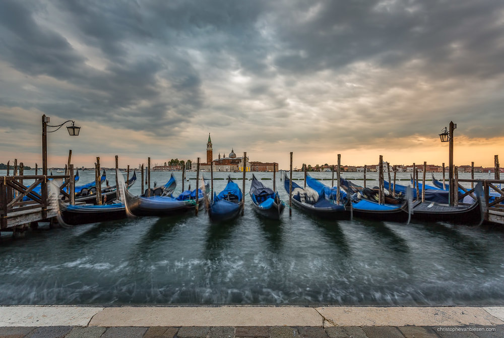 Venice - Italy - Floating Gondolas under a dramatic sunset sky in Venice, Italy - Gondolas Unleashed