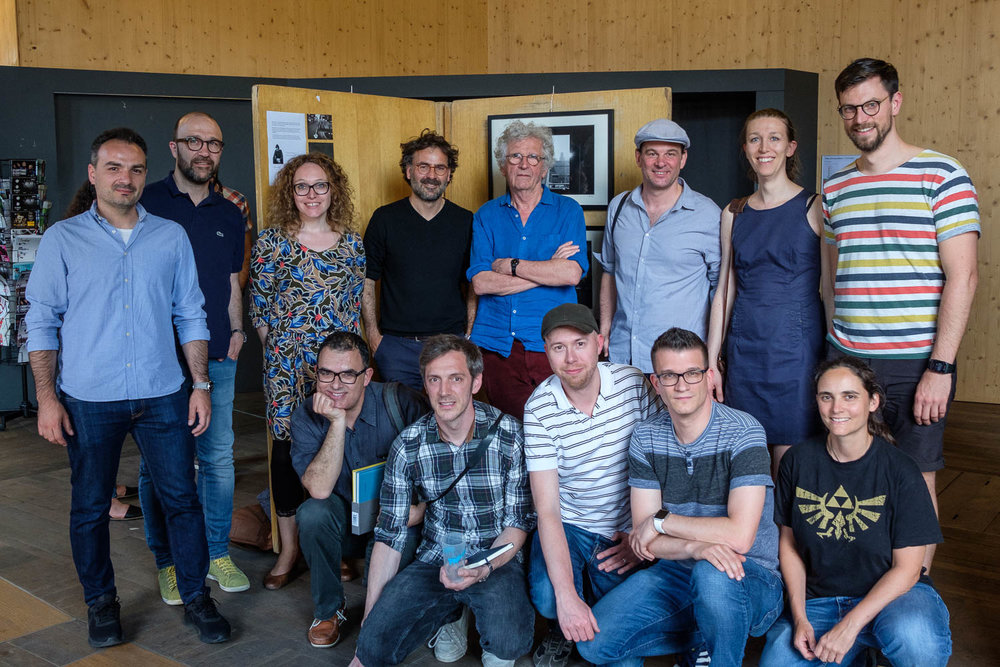Luxembourg Street Photography Festival at Rotondes - LSPF 2018 From left to right, top row: Catalin Burlacu, Jeff Mouton, Veronique Kolber, Txema Salvans, Harry Gruyaert, Christian Reister, Giulia Thinnes, Tom Weis From left to right, bottom row: Paulo Lobo, Dirk Mevis, Christophe Van Biesen, Paul Bintner, Véronique Fixmer