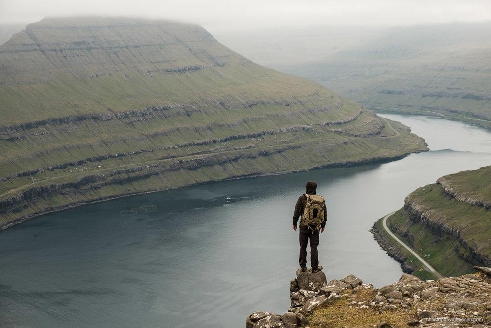 Faroe Islands - Denmark - Traveller atop the island of Eysturoy in the Faroes Islands near Funningur
