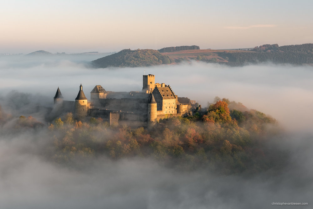 Bourscheid Castle in the fog - Chateau de Bourscheid - Luxembourg - Bourscheid castle in the fog during an autumn sunrise - Fortress Rising from the Fog