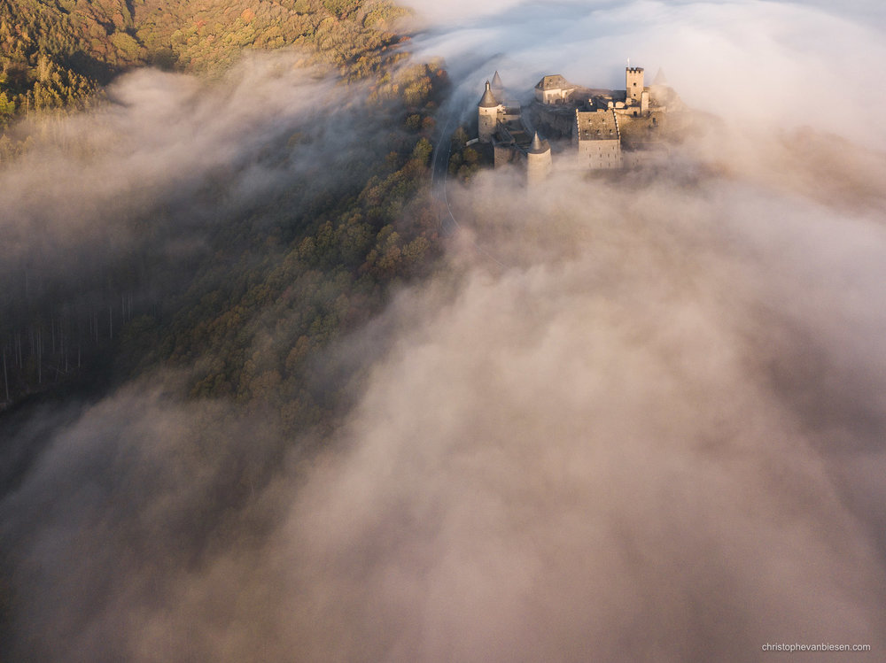 Bourscheid Castle in the fog - Chateau de Bourscheid - Luxembourg - Drone - Bourscheid Castle perched above the valley of the Sûre - Medieval Stronghold