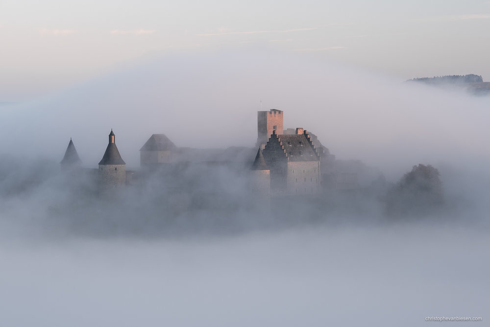 Bourscheid Castle in the fog - Chateau de Bourscheid - Luxembourg - Bourscheid Castle engulfed by inverted clouds on an autumn morning - Tidal Wave