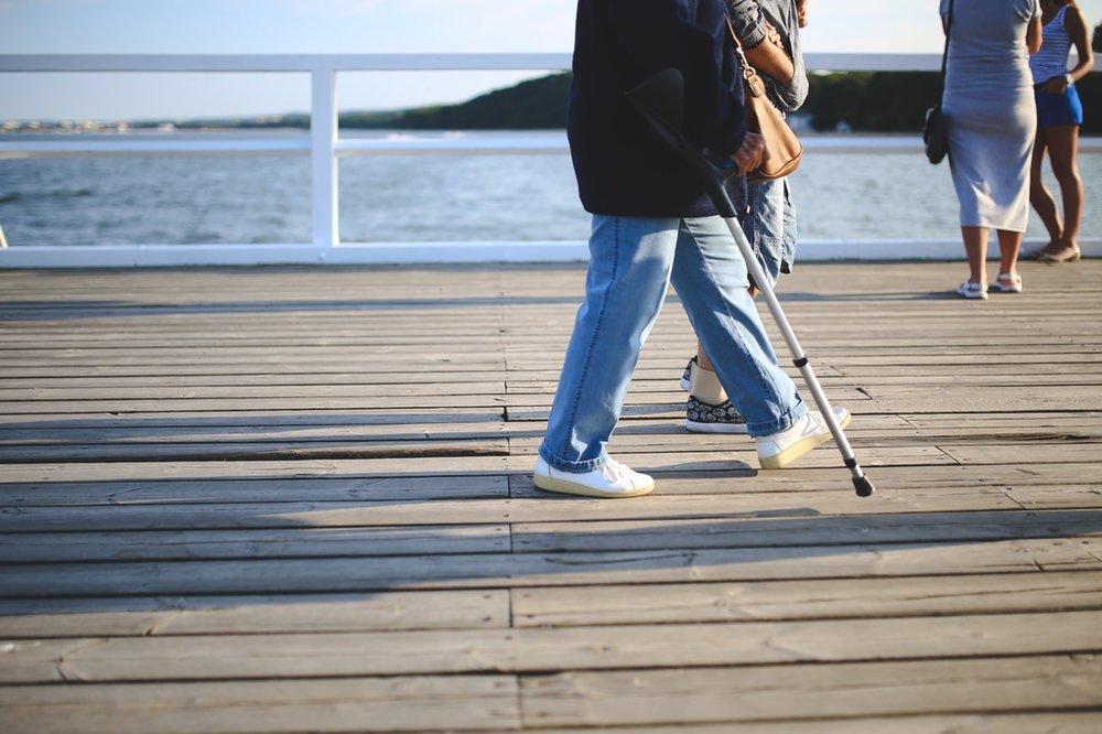 woman-walking-jeans-pier.jpg