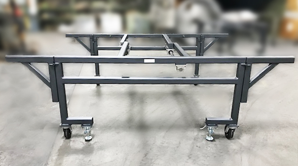 Material Handling Solutions: - Moving oversized parts/assembliesAutomate the movement of large equipment within your operation so your employees are no longer put at risk by manually moving oversized parts and assemblies.