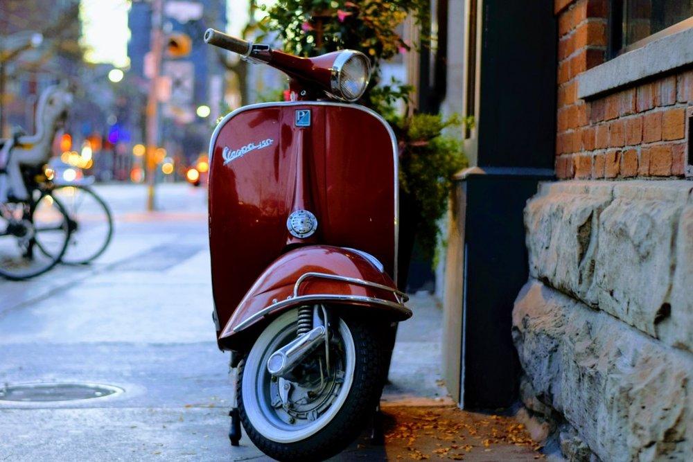 Moped-parked-on-sidewalk.jpeg