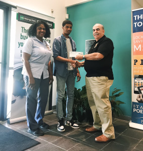 Charles Watkins V and his mother, Dena Watkins accept the Youth Saving Challenge prize from POECU president, Sidney Parfait.