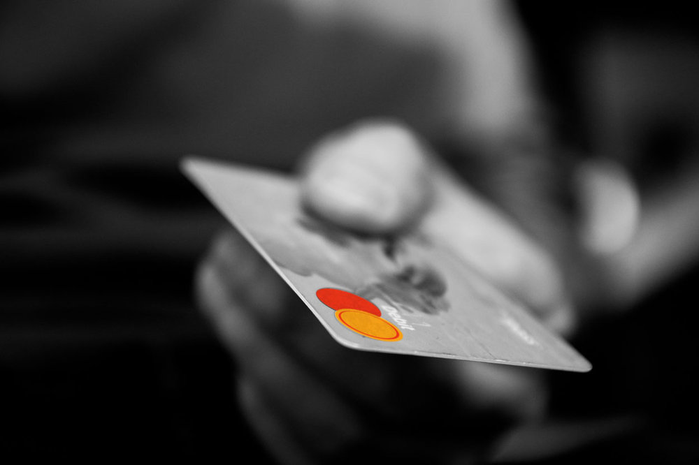 hand-holding-debit-card.jpg