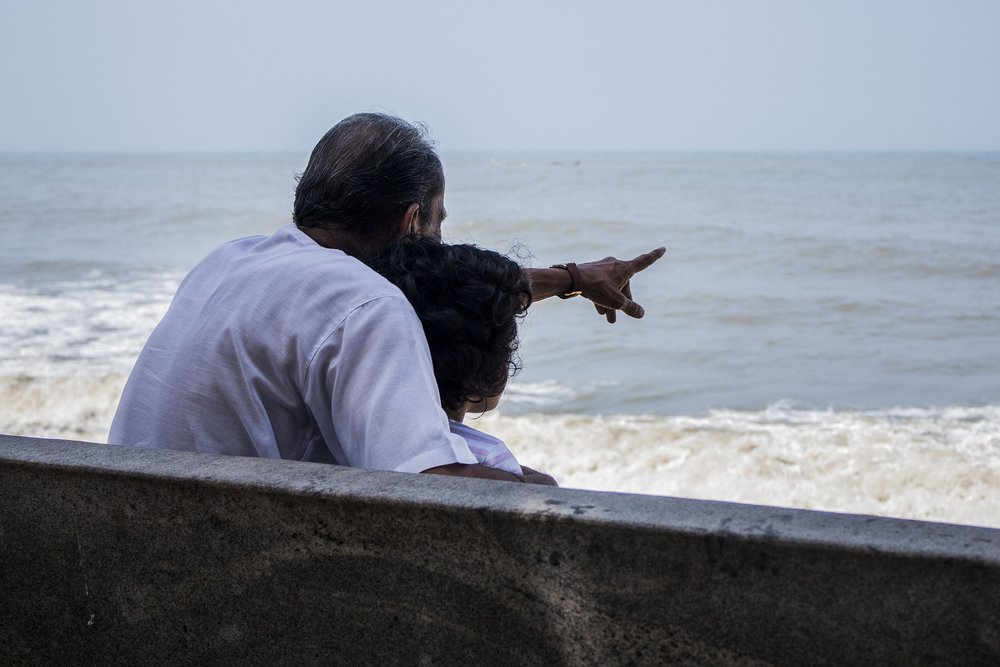 grandfather-with-grandchild-at-beach.jpg
