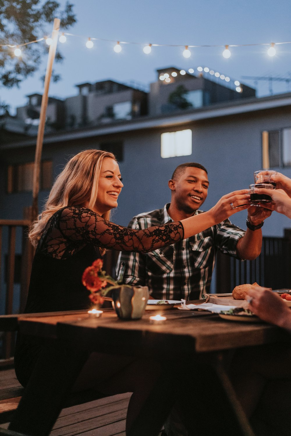 adult-friends-cheers-at-rooftop-restaurant.jpg