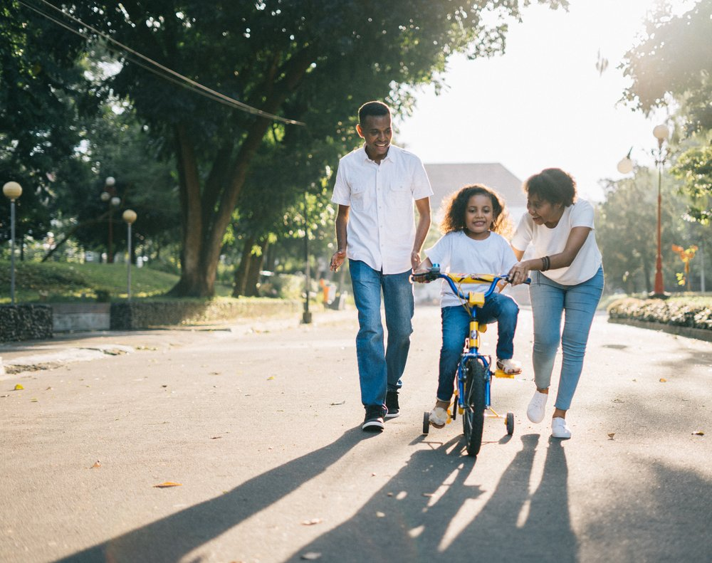 family_riding_bike_mom_dad_daughter.jpg
