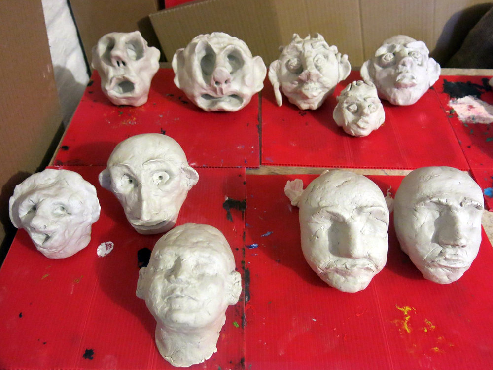 Close up of clay heads made at the art class