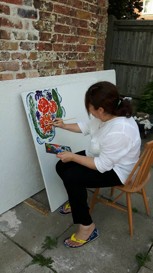 Painting wooden board at The White House art class