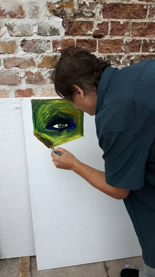 Miro Tomarkin painting an eye at The White House